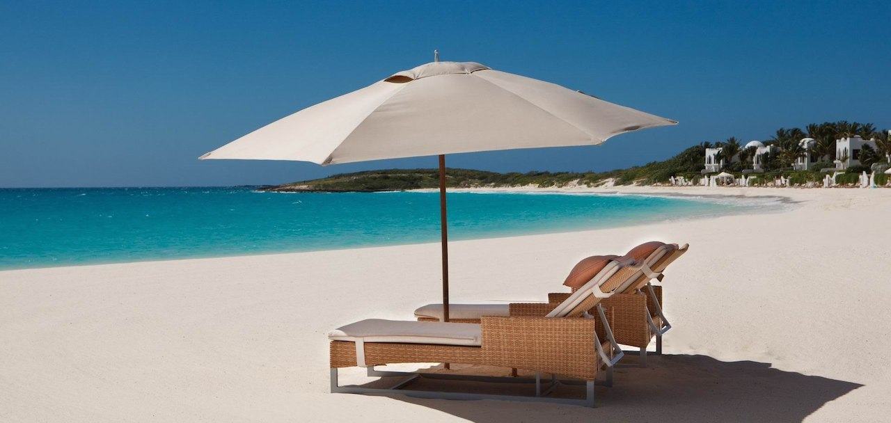 home-james-global-real-estate-anguilla-beach-umbrella